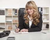 Young blond attractive business woman — Stok fotoğraf