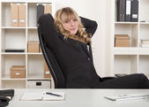 Young blond attractive business woman — Stockfoto
