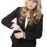 Businesswoman pointing to her wristwatch — Stock Photo