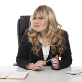 Confused businesswoman with a puzzled frown — Stock Photo