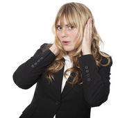 Businesswoman covering her ears — Stock Photo
