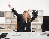 Jubilant businesswoman celebrating — Stock Photo
