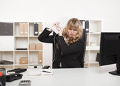 Angry businesswoman throwing a tantrum — Stock Photo