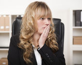 Young businesswoman looking worried — Stock Photo