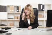Blond businesswoman talking on the phone — Stock Photo