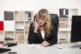 Attractive businesswoman chatting on the phone — Stock Photo