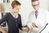 Doctor with young female patient woman — Stock Photo
