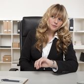 Businesswoman looking at her watch — Stock Photo