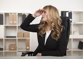 Businesswoman staring into the distance waiting — Stock Photo