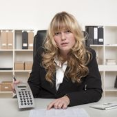 Businesswoman questioning a report — Stock Photo