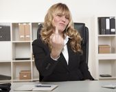 Businesswoman making a rude gesture — Stock Photo