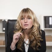 Attentive attractive young businesswoman — Stock Photo