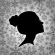 Silhouette of a female head against from snowflakes — Stock Vector