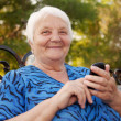 Senior Woman and new technologies — Stock Photo #23002070