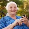 Senior Woman and new technologies — Stock Photo