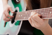 The girl plays a guitar — Stock Photo