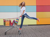 Girl with shopping trolley — Stock Photo