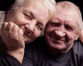 Happy older pair on a black background — Stock Photo