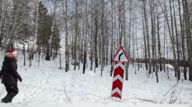Women in cap Santa Claus walking in the woods — Stock Video
