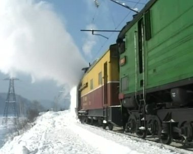 Snowfall and train — Stockvideo