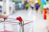 Shopping trolley in motion — Stock Photo