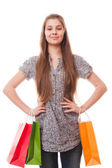 Teenager girl with shopping bags — Stockfoto