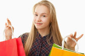 Teenager girl with shopping bags — Stock Photo