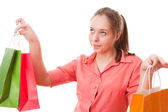Tiener meisje met shopping tassen — Stockfoto