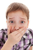 Boy covering his mouth and looking very shocked — Stock Photo