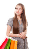 Teenager girl with shopping bags — Photo