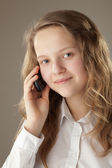 Teenager girl and mobile phone — Stockfoto