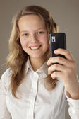 Teenager girl and mobile phone — Stock Photo