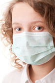 Teenager boy in surgical mask — Stock Photo
