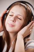 Teenager in earphones — Stock Photo