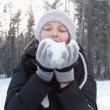 Girl blowing on snow — Stock Video