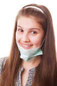 Teenager girl in surgical mask — Stock Photo