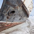 Frozen boat at the shore — Stock Photo
