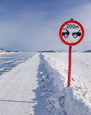 Sign on icy road — Stock Photo