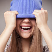 Girl holding cap and smile — Stock Photo