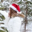 Cheerful Woman Talking on the Phone in the Bell Santa Claus — Stock Video