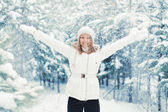 Woman Pleases the First Snow — Stock Photo