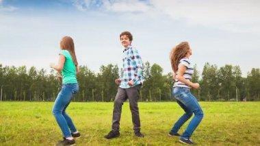Teens Dancing in a Meadow — Stock Video