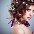 Young beautiful woman with flowers in her hair and bright makeup — Stock Photo