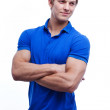Portrait of a young handsome man wearing blue t-short — Stock Photo #33621691