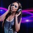 Woman DJ enjoying the music in the headphones — Stock Photo