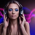 Young DJ woman enjoying the music in the headphones — Stock Photo #33621975