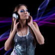 Young DJ woman enjoying the music in the headphones — Stock Photo #33622065