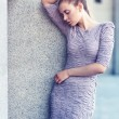 Outdoor fashion portrait of young woman in lilac dress — Stock Photo