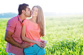 Romantic young couple in a field — Stock Photo