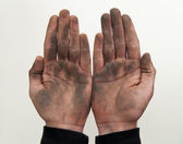 Man show his dirty hands with palms up isolated on white. — Stock fotografie